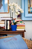 Pale blue cushion cover with stylised fork motif in living room