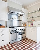 Professional cooker and red and white chequered floor in spacious kitchen