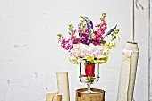 Summer bouquet of hydrangeas, stocks & speedwell in glass vase