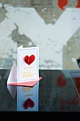 Gift voucher card for romantic Valentine's-day dinner with sewn-on heart and pasta letters