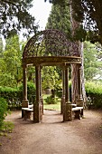 Round pavilion with wrought iron, lattice cupola in gardens of Villa Cimbrone