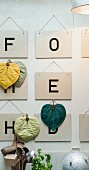 Letter signs and homemade potholders as wall decoration