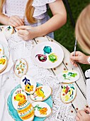 Girls paint Easter cookies