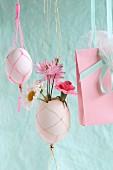 Flowers in blown Easter egg in macrame holder