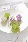 Homemade decorative diamonds made from stiff, coloured paper