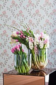 Pink tulips, lisianthus and hyacinths in glass vases