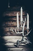 Rustic candelabra against wooden background
