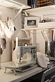 Old sewing machine and fabric love-hearts on workbench