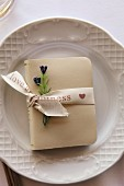 Small book tied with ribbon as table decoration for wedding