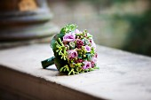 Bridal bouquet on old wall