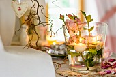 Table arrangement of roses and floating candles