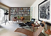 Eames Lounge Chair, dining area and bookcase in living room
