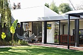 Butterfly chair on roofed terrace of modern bungalow