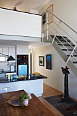 Kitchen-dining room and stairs leading to gallery in apartment