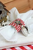 Festive napkin ring hand-crafted from red and white cord