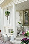 Flowers and curtains on veranda of Swedish house