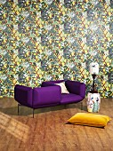 Purple designer armchair, yellow cushion and Chinese porcelain against patterned wallpaper