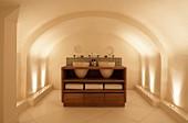 Wooden washstand with integrated basins in designer bathroom