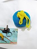 A homemade, fold-way crocheted shopping bag