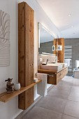 A made-to-measure wooden cupboard next to a washstand in a modern bathroom
