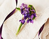 Posy of violets decorating table