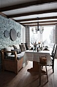 Rustic dining area with bench against stone wall