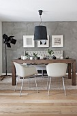 Modern furniture in Scandinavian dining room with concrete-effect wall