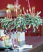 Suspended Advent wreath of olive branches decorated with glass droplets