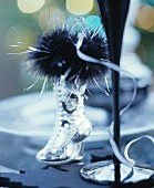 Christmas table decoration with silver boot & feather boa
