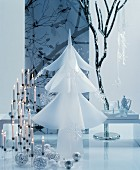 Room festively decorated in white with candelabra, baubles and white Christmas tree