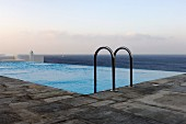 Outdoor infinity pool with panoramic ocean view