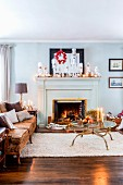Sofa next to fireplace festively decorated with white nutcracker figurines