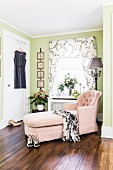 Pink chaise chair in corner