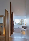 Designer-style ensuite bathroom with sliding windows and mosaic tiles