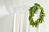 Wreath of hops hanging on chair backrest