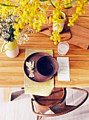 View of laid table with wooden board, menu card and yellow flowers