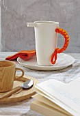 A crocheted handle cover on a jug
