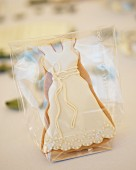 Iced, wedding-dress biscuit as wedding favour