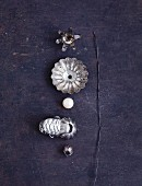 A dismantled Christmas tree candle holder, a mother-of-pearl bead and florist's wire