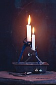 Old pliers being used as candle holders