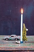 Toy cars as a candle holder as Christmas decoration