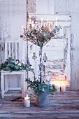 An olive tree decorated with burning candles for Christmas