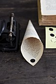 A homemade cone made from a page of a book