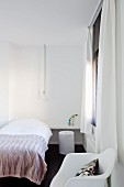 Single bed and white classic chair in small, minimalist bedroom