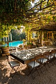 Rustic wooden table and swimming pool on restaurant terrace