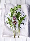 Spring flowers on a clock face with Roman numerals