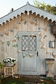 Pretty garden shed decorated with hand-made bunting