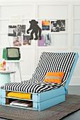 A homemade lounger made from light blue wooden pallets