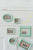 Homemade door plaques made from turquoise picture frames
