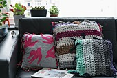 Various sewn and crocheted decorative cushions